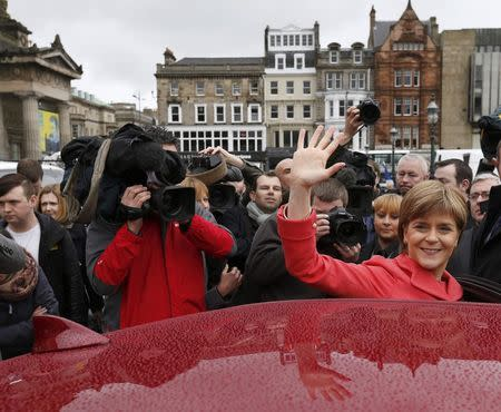 Nicola Sturgeon, leader of the Scottish National Party, waves as she gets in her car  following her speech on the final day of campaigning in Edinburgh Scotland
