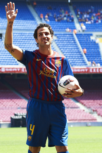 Barcelona's new player Cesc Fabregas waves during his presentation at Nou Camp stadium in Barcelona, Spain, Monday, Aug. 15, 2011. Fabregas, who came back to his boyhood club after eight seasons with Arsenal, signed a five-year contract Monday. Terms of Fabregas' contract were not announced but Spanish media reported the price tag of the transfer at about euro 40 million ($57 million). (AP Photo/Siu Wu)