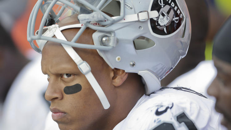 Oakland Raiders defensive end Jack Crawford (91) watches from the bench during the fourth quarter of an NFL football game, Sunday, Sept. 30, 2012, in Denver. (AP Photo/Joe Mahoney)