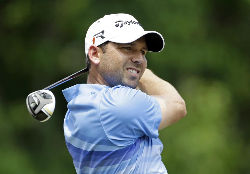 Sergio Garcia of Spain,  watches his shot from the second tee during the third round of The Players championship golf tournament at TPC Sawgrass, Saturday, May 11, 2013, in Ponte Vedra Beach, Fla. (AP Photo/Gerald Herbert)