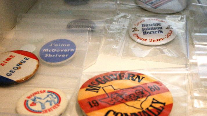 This Jan. 17, 2013, photo shows a George McGovern campaign button. Personal items belonging to the three-time presidential hopeful and former U.S. senator are going to be sold during an estate sale at his Sioux Falls' home Saturday and Sunday. McGovern died in October at age 90. (AP Photo/Kristi Eaton)