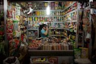 &lt;p&gt;A vendor stands behind a stall at a market in Beijing in August 2012. China&#39;s economy, which grew on average more than 10 percent in the decade through 2010, has slowed since early last year amid broader global woes in major export markets Europe and the United States.&lt;/p&gt;