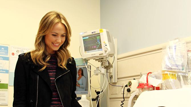 Stacy Keibler delivered The Art of Elysium Holiday Art Kits provided by Faring Capital to patients at Kaiser Permanente in Los Angeles, Dec. 19, 2012. (Photo by Matt Sayles/Invision for Faring Capital/AP Images)