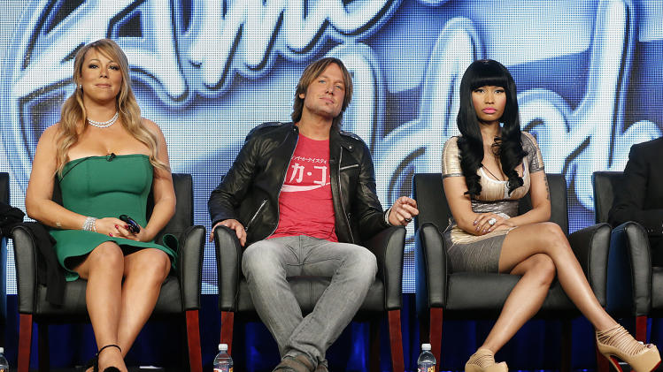 "Mariah Carey, Keith Urban and Nicki Minaj from ""American Idol"" attends the Fox Winter TCA Tour at the Langham Huntington Hotel on Tuesday, Jan. 8, 2013, in Pasadena, Calif. (Photo by Todd Williamson/Invision/AP)"