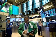 Traders work on the floor of the New York Stock Exchange in New York City. Stocks rose after Ben Bernanke expressed deep worry over the US economy and unemployment Friday, sending a strong signal that he wants the central bank to take fresh action to stimulate growth