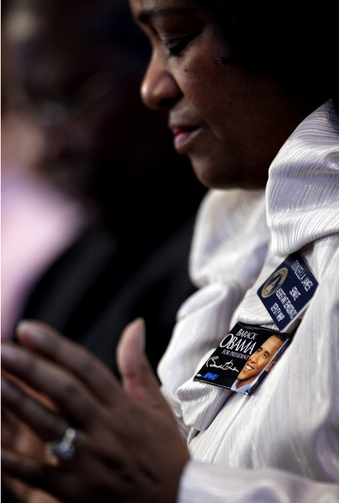 Sen. Donzella James, D-College Park, wears a President Barack Obama pin as she prays during the annual Dr. Martin Luther King Jr. holiday commemorative service at the Ebenezer Baptist Church, Monday,
