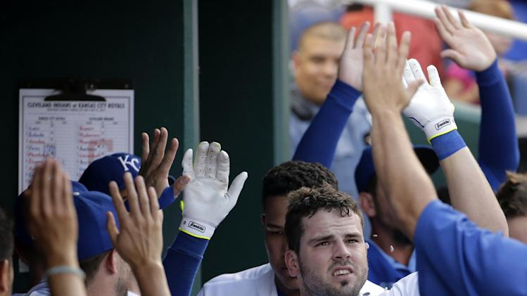 Kansas City Royals' Mike Moustakas celebrates in the dugout after hitting a solo home run during the second inning of a baseball game against the Cleveland Indians, Friday, July 25, 2014, in Kansas City, Mo. (AP Photo/Charlie Riedel)