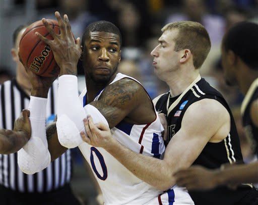 Johnson rallies Kansas to 63-60 win over Purdue