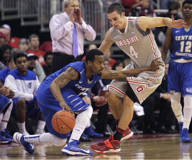 Central Connecticut's Kyle Vinales, left, tries to dribble past Ohio State's Aaron Craft during the second half of an NCAA college basketball game Saturday, Dec. 7, 2013, in Columbus, Ohio. Oh