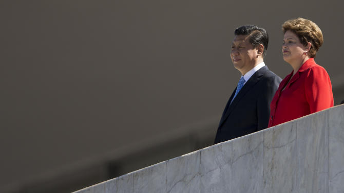 Brazil's President Dilma Rousseff, right, and China's President Xi Jinping watch a ceremony before their meeting at the Planalto Presidential Palace in Brasilia, Brazil, Thursday, July 17, 2014. (AP Photo/Felipe Dana)