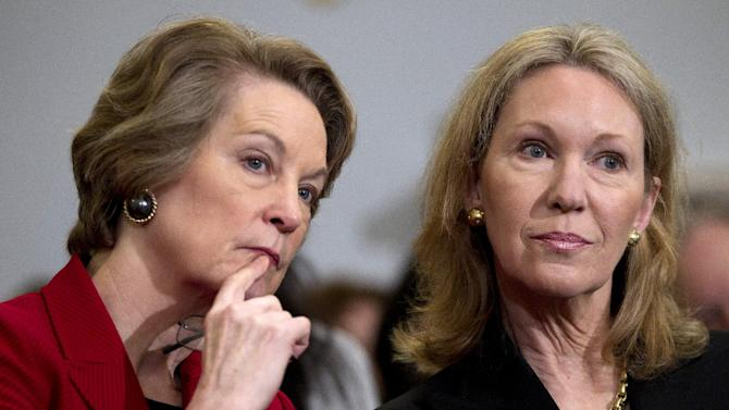 Susan Eisenhower, left, and Anne Eisenhower, right, granddaughters of President Dwight D. Eisenhower, listen to testimony on Capitol Hill in Washington, Tuesday, March 20, 2012, during the House National Parks, Forest and Public Lands subcommittee hearing on the proposed Dwight D. Eisenhower Memorial on the National Mall . (AP Photo/Carolyn Kaster)