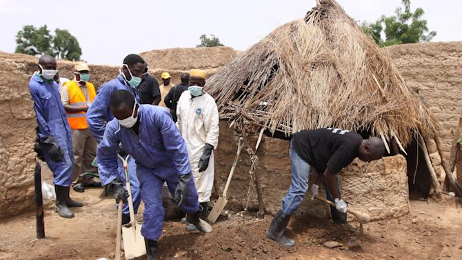 FILE - A Thursday, June 10, 2010 photo from files showing local health workers removing earth contaminated by lead from a family compound in the village of Dareta in Gusau, Nigeria. The Nigerian village that suffered one of the worst recorded incidents of lead poisoning is now habitable and doctors can start treating more than 1,000 contaminated children, a doctor and a scientist from two international agencies said Friday. For some, it already is too late to reverse serious neurological damage, said Dr. Michelle Chouinard, Nigeria country director for Doctors Without Borders, told The Associated Press on Friday, Aug. 2, 2013. Some children are blind, others paralyzed, many will struggle at school with learning disabilities, she said. Doctors Without Borders uncovered the scandal in 2010 but nothing was done until this year about the worst-affected village, Bagega, because the federal government did not provide a promised $3 million, the group said. (AP Photo/Sunday Alamba, File)