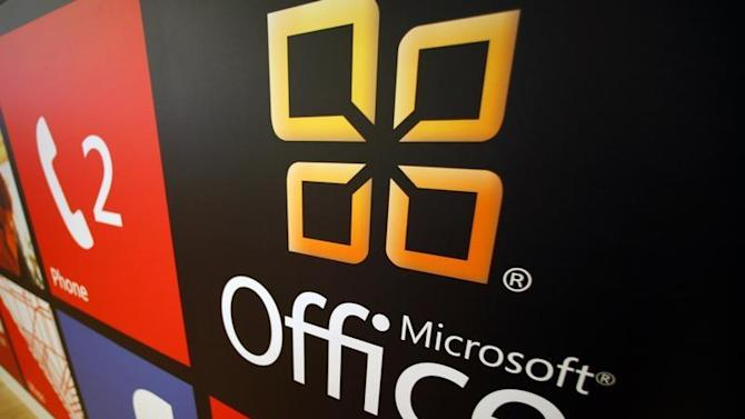 A Microsoft Office logo is shown on display at a Microsoft retail store in San Diego