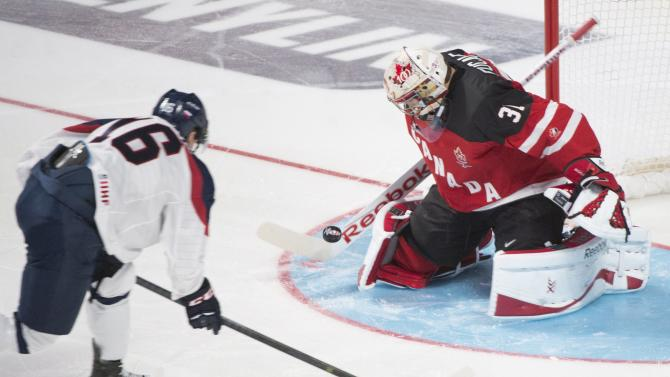 Canada goaltender Zach Fucale makes a save against Slovakia's Robert Lantosi during the first period of a round-robin game at the hockey World Junior Championship, Friday, Dec. 26, 2014, in  Montreal. (AP Photo/The Canadian Press, Graham Hughes)