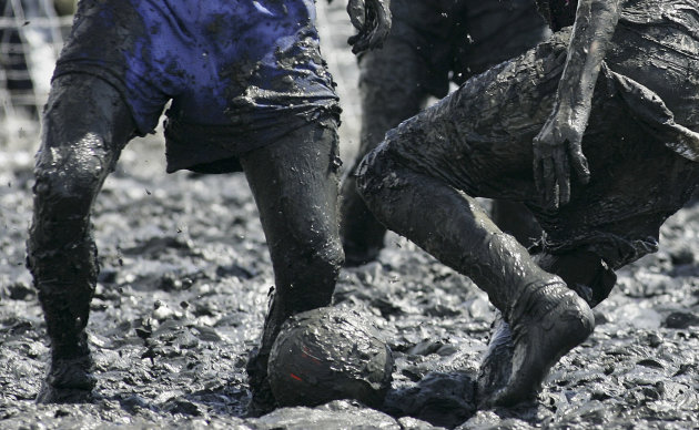 FILE - This July 8, 2007 file photo shows people playing soccer in the mud of the Elbe River near Brunsbuettel, some ten kilometers off the North Sea, northern Germany. Soccer is falling under a cloud of suspicion as never before, sullied by a multibillion-dollar web of match-fixing that is staining increasingly larger parts of the world&#39;s most popular sport. (AP Photo/Heribert Proepper, file)