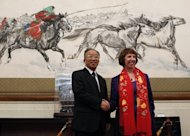 EU foreign policy chief Catherine Ashton (R) and Chinese State Councillor Dai Bingguo shake hands before talks for the third EU-China Strategic Dialogue meeting in Beijing. China said it believed Europe could resolve its debt crisis, as the two sides held a high-level meeting in Beijing that also covered thorny issues such as Syria, Iran and human rights