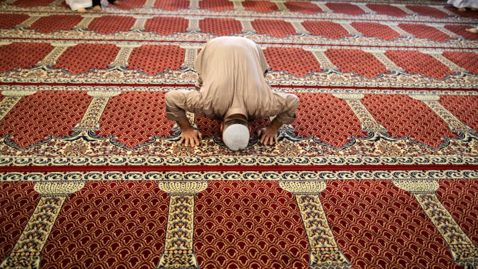 An elderly Syrian man offers prayers in a mosque in Kafar Hamra, on the outskirts of Aleppo, Syria, Wednesday, Aug. 22, 2012. (AP Photo/Muhammed Muheisen)