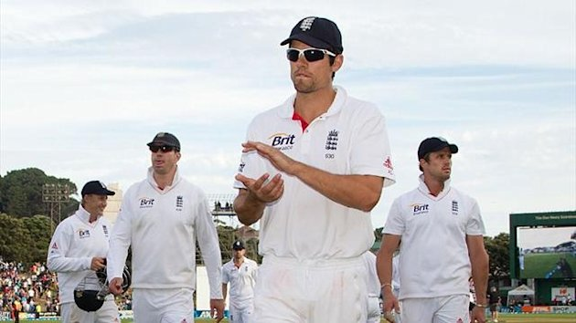 England captain Alastair Cook leads off his players in Wellington (AFP)