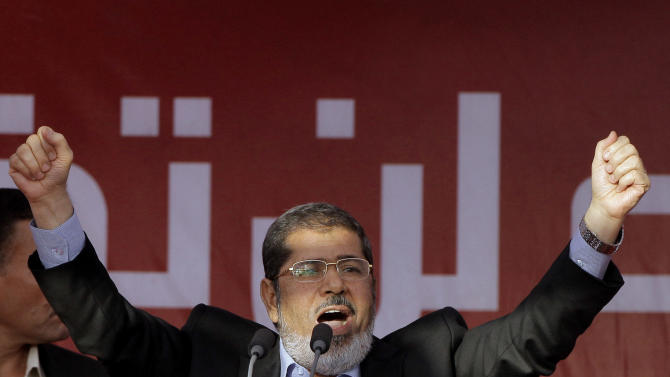 FILE - In this Friday, June 29, 2012 file photo, Egypt's President-elect Mohammed Morsi talks to his supporters at Tahrir Square, the focal point of Egyptian uprising, during his speech in Cairo, Egypt. On Tuesday April 21, 2015, an Egyptian criminal court  sentenced  Morsi to 20 years in prison over the killing of protesters in December 2012, the first verdict to be issued against the leader. Morsi faces several other trials along with thousands of Muslim Brotherhood members following the military overthrowing him in 2013.. (AP Photo/Amr Nabil, File)