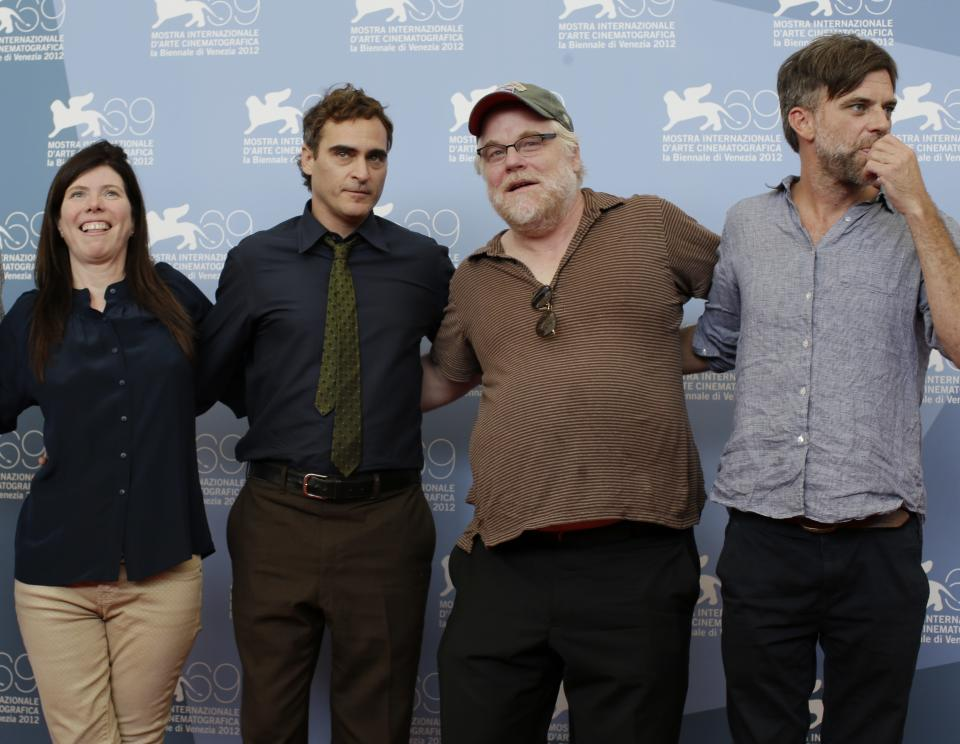From left, producer JoAnne Sellar, actors Joaquin Phoenix, Philip Seymour Hoffman and Director Paul Thomas Anderson pose at the photo call for the film 'The Master' at the 69th edition of the Venice Film Festival in Venice, Italy, Saturday, Sept. 1, 2012. (AP Photo/Andrew Medichini)
