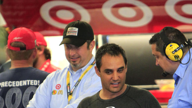 Juan Pablo Montoya, center, of Colombia, talks to team members in his garage after he was involved in a crash in the NASCAR Daytona 500 auto race at Daytona International Speedway in Daytona Beach, Fla., Monday, Feb. 27, 2012. (AP Photo/John Raoux)