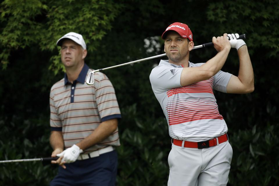 Sergio Garcia, right, of Spain, and Stewart Cink watch Garcia's tee shot on the 11th hole during the first round of the U.S. Open golf tournament at Merion Golf Club, Thursday, June 13, 2013, in Ardmore, Pa. (AP Photo/Morry Gash)