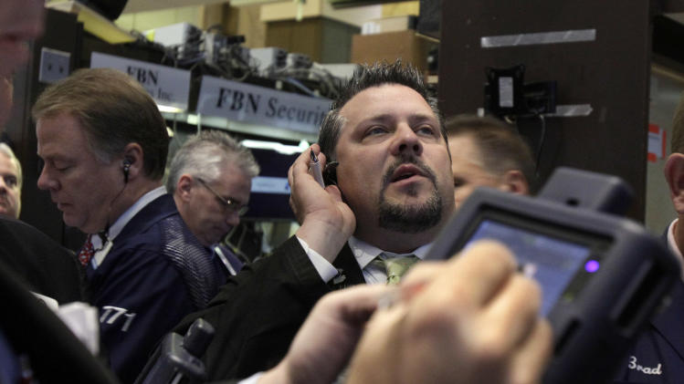 In this May 11, 2012, photo, trader Jason Harper, right, works on the floor of the New York Stock Exchange.  Wall Street ended last week with a decline after JPMorgan said it lost $2 billion on poorly-thought-out trades.   (AP Photo/Richard Drew)