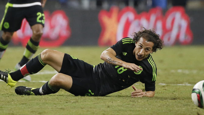 FILE - In this Sept. 8, 2015 file photo, Mexico captain Andres Guardado eyes the ball after falling during a friendly soccer match against Argentina at the AT&T Stadium in Arlington, Texas. Guardado will miss his country's Confederations Cup playoff against the United States next month after tests confirmed that he sustained ankle ligament damage in the 70th minute of PSV Eindhoven's surprise 2-1 Champions League defeat of Manchester United on Sept. 15. (AP Photo/Tony Gutierrez, File)