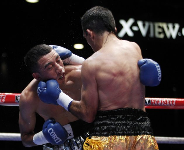 WBO champion Omar Narvaez of Argentina punches Felipe Orucuta of Mexico during their super flyweight world title bout at the Luna Park Arena in Buenos Aires