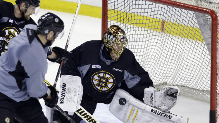 Boston Bruins goalie Tuukka Rask makes a pad save during practice at TD Garden in Boston, Monday, June 10, 2013. The Bruins are preparing to face the Chicago Blackhawks in the NHL hockey Stanley Cup finals with Game 1 scheduled for Wednesday in Chicago. (AP Photo/Elise Amendola)