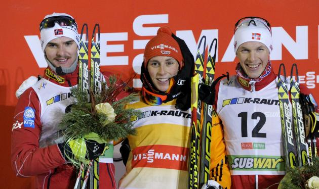 Graabak of Norway, Frenzel of Germany and Krog of Norway pose on the podium as they celebrate after the men's 10m km cross country skiing of Nordic Combined at the FIS World Cup Ruka Nordic Opening in