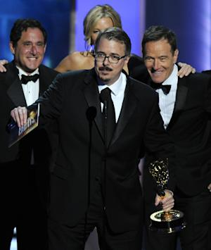 """Vince Gilligan, center, and the cast and crew of """"Breaking Bad"""" accept the award for outstanding drama series at the 65th Primetime Emmy Awards at Nokia Theatre on Sunday Sept. 22, 2013, in Los Angeles. (Photo by Chris Pizzello/Invision/AP)"""