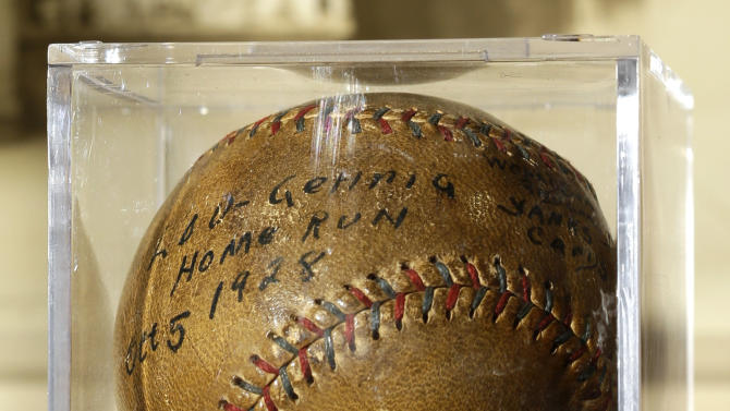 A baseball that New York Yankees slugger Lou Gehrig hit for a World Series home run in 1928 is on display at a convention center in Kansas City, Mo., Thursday, July 5, 2012. Stamford, Conn., resident Elizabeth Gott is selling the baseball at auction on behalf of her 30-year-old son, Michael, to help pay off his medical school debts. (AP Photo/Charlie Riedel)