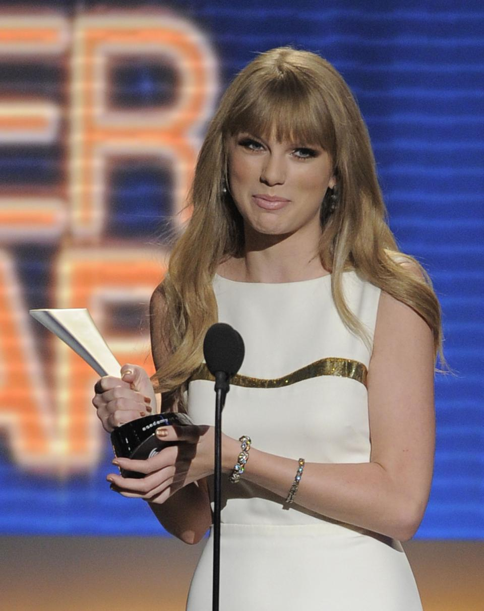 Taylor Swift accepts the award for entertainer of the year at the 47th Annual Academy of Country Music Awards on Sunday, April 1, 2012 in Las Vegas. (AP Photo/Mark J. Terrill)