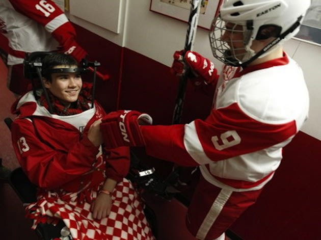 Paralyzed Benilde-St. Margaret's hockey player Jack Jablonski fist bumps a teammate &#x002014; AP/The Star Tribune, Carlos Gonzalez