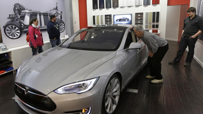 Tesla loses $50 million in 1Q as costs rise