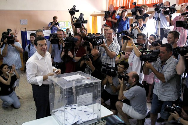 Head of Greece's radical left-wing Syriza party Alexis Tsipras casts his ballot at a voting center in Athens, Sunday, June 17, 2012. Greeks voted Sunday for the second time in six weeks in what was ar