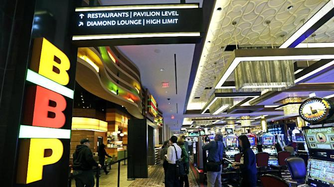 Work continues in Horseshoe Casino Cincinnati, Tuesday, Feb. 26, 2013, in Cincinnati. The casino set to open to the public Monday, March 4, has several restaurants inside including Bobby Flay's Burger Palace. (AP Photo/Al Behrman)