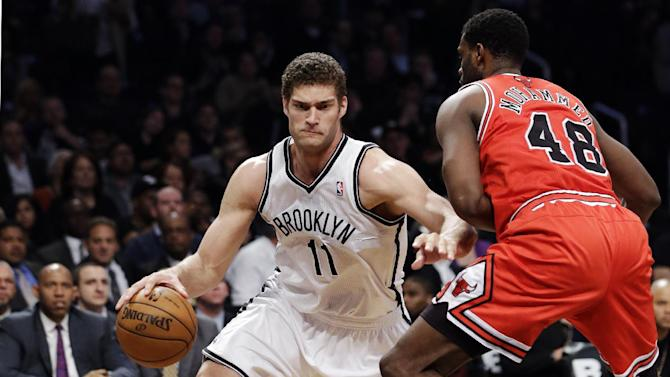 Brooklyn Nets center Brook Lopez (11) drives past Chicago Bulls center Nazr Mohammed (48) in the first half of Game 5 of their first-round NBA basketball playoff series, Monday, April 29, 2013, in New York. (AP Photo/Kathy Willens)
