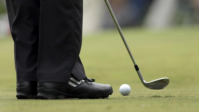 Sergio Garcia, of Spain, uses a wedge instead of his putter  to make a putt on the third green during the second round of the Wells Fargo Championship golf tournament at Quail Hollow Club in Charlotte, N.C., Friday, May 3, 2013. (AP Photo/Chuck Burton)