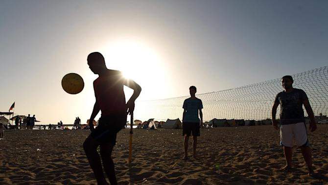 Libyans play footvolley on a beach on June 27, 2014 in the eastern city of Benghazi
