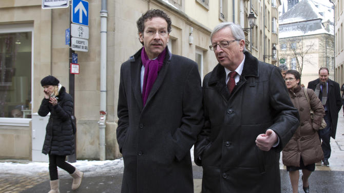 FILE  - In this Friday, Jan. 18, 2013 file photo, Luxembourg's Prime Minister and and former head of the eurogroup Jean-Claude Juncker, right, walks with Dutch Finance Minister Jeroen Dijsselbloem in Luxembourg. Luxembourg said it will start exchanging information with the rest of Europe to help fight tax evasion, the government said Wednesday, April 10, 2013 in a move it hopes will give the country a more transparent financial industry. The decision follows international pressure on Luxembourg to end its policy of banking secrecy that critics argue helps people hide money in the tiny country of half a million people from tax authorities. (AP Photo/Virginia Mayo, File)