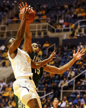 West Virginia drubs Loyola (Md.) 96-47