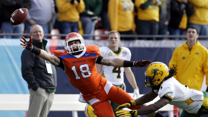 Sam Houston State's Trey Diller (18) reaches out but is unable to grab a pass as North Dakota State's Marcus Williams (1) defends during the first half of the FCS Championship NCAA college football game Saturday, Jan. 5, 2013, in Frisco, Texas. (AP Photo/Tony Gutierrez)