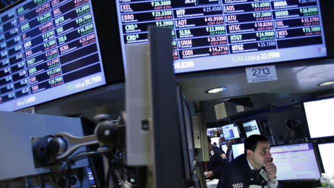 A trader works on the floor at the New York Stock Exchange in New York, Friday, Dec. 28, 2012. Stocks were heading lower Friday, for a fifth day, on concern that Washington lawmakers will fail to reach a budget deal before a year-end deadline. (AP Photo/Seth Wenig)