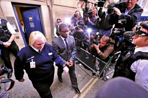 <p>UBS equities trader Kweku Adoboli (C) leaves City of London Magistrates court, in central London, in 2011. A trader accused of a $2.3 billion fraud at Swiss bank UBS was due to go on trial Monday in London in a case expected to once again put the supervision of bankers under the spotlight.</p>