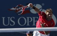 Stanislas Wawrinka of Switzerland serves to Andy Murray of Britain at the U.S. Open tennis championships in New York September 5, 2013. REUTERS/Mike Segar