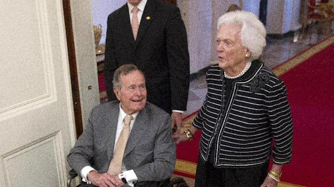 FILE - In this May 31, 2012 file photo, former President George H.W. Bush, left, and his wife, former first lady Barbara Bush, arrive in the East Room of the White House in Washington, for a ceremony to unveil the official portrait of their son former President George W. Bush. Bush and his wife Barbara won't be attending the Republican National Convention next month in Tampa because of health reasons.  (AP Photo/Pablo Martinez Monsivais)