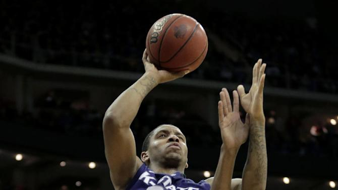 Kansas State guard Rodney McGruder (22) gets past Kansas forward Kevin Young (40) to put up a shot during the first half of the championship NCAA college basketball game of the Big 12 men's tournament Saturday, March 16, 2013, in Kansas City, Mo. (AP Photo/Charlie Riedel)
