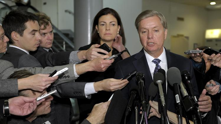 FILE – In this Nov. 27, 2012, file photo Senate Armed Services Committee members, Sen. Lindsey Graham, R-S.C., foreground, and Sen. Kelly Ayotte, R-N.H., speak to reporters on Capitol Hill in Washington after meeting with UN Ambassador Susan Rice to discuss statements she made about the attack on the U.S. Consulate in Libya that killed four Americans. Republicans and Democrats began condemning each other's response to Benghazi within hours of the first shots fired. The issue has flared and dimmed ever since, revived by new testimony, reports or documents like newly released emails.  (AP Photo/Susan Walsh, File)